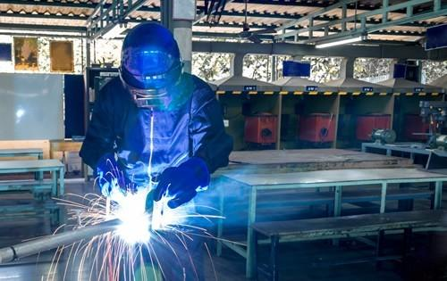 person-welding-factory